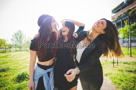 three young female friends laughing together