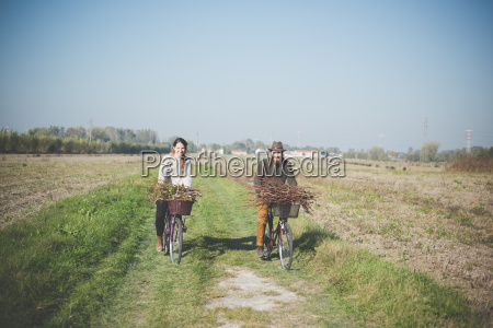 young couple cycling in countryside dolo