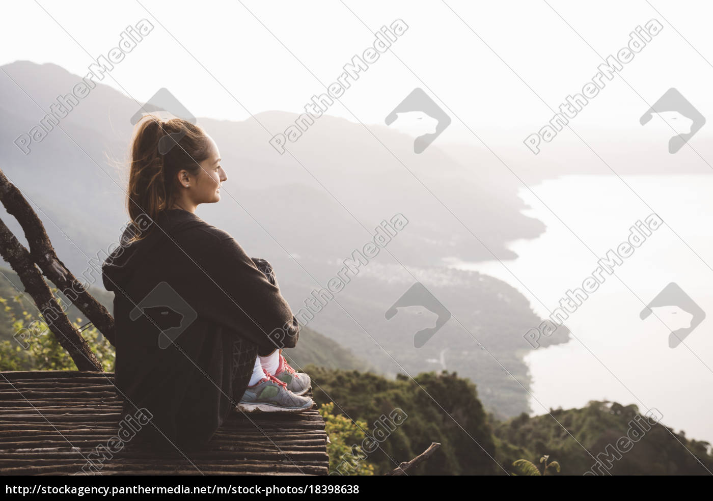 young, woman, on, balcony, looking, out - 18398638