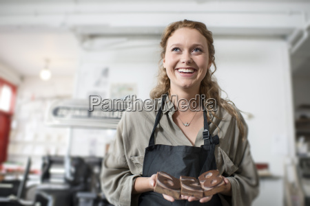 young woman with wooden letterpress in