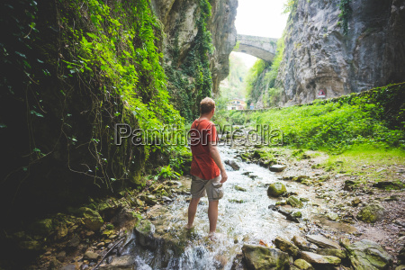man standing in stream rock hills
