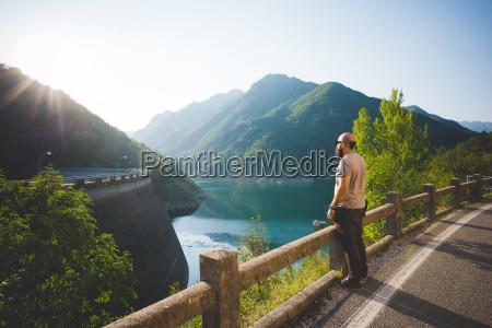 man enjoying view of lake garda
