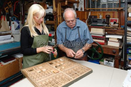 senior man and young woman assembling
