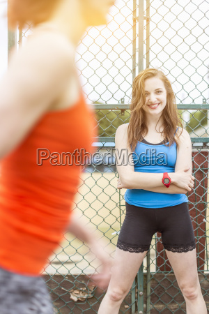 runner passing young woman standing beside