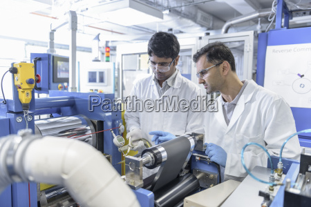 scientists with lithium ion battery production