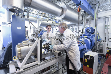 scientists testing lithium car battery with