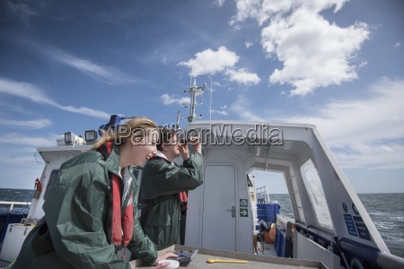 scientists inspecting plankton samples on research