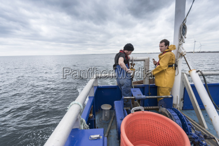 research scientist and fisherman pay out