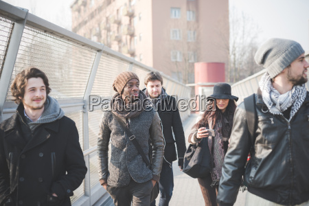 five young adult friends strolling on