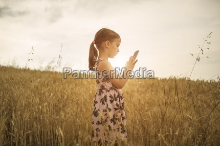 girl concentrating on smartphone touchscreen in