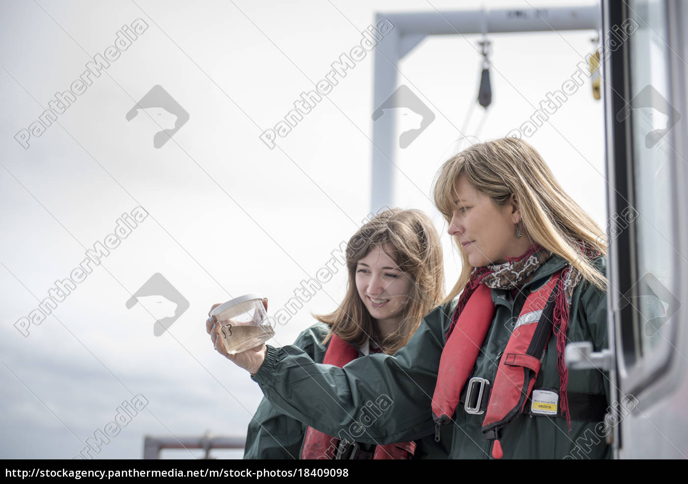 female, scientists, inspecting, sample, of, plankton - 18409098