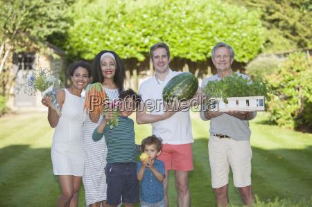 portrait of family in garden holding