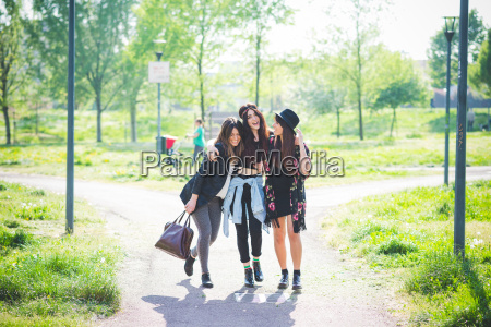 three young female friends strolling together