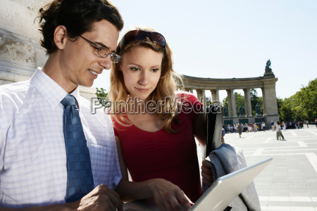 businessman and businesswoman outdoors with a