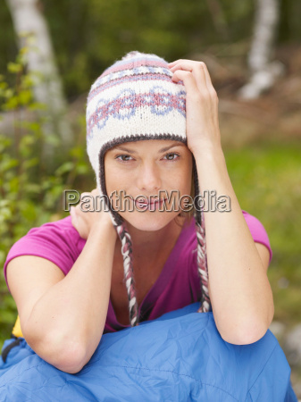 woman sitting with a sleeping bag