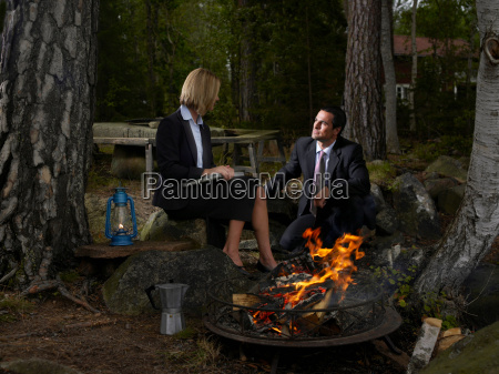 business meeting by a camp fire
