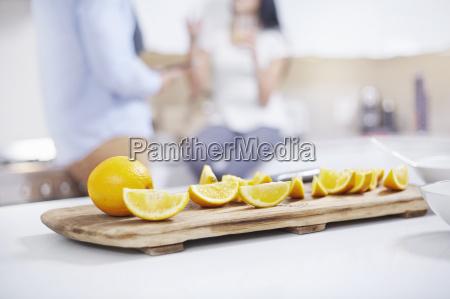 quartered oranges on kitchen counter in