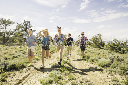 teenage girl and adult friends running