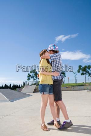 teen couple kissing