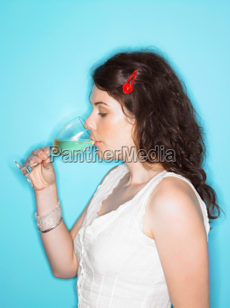 young woman sipping white wine
