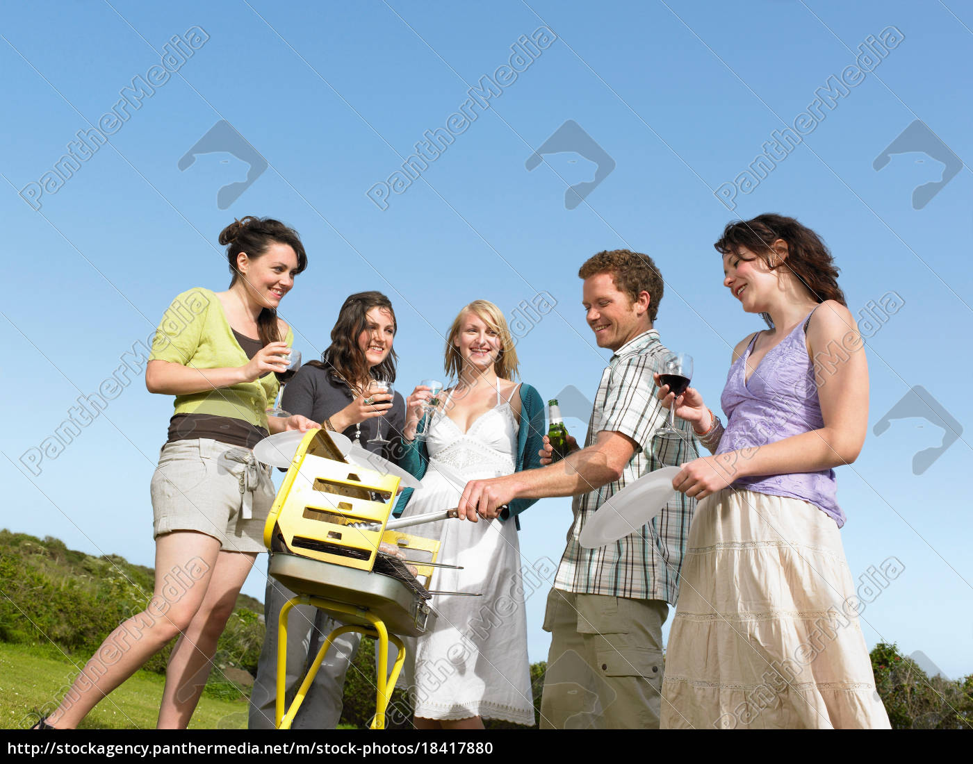 group, of, young, people, by, barbecue - 18417880
