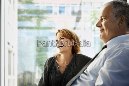 man and woman smiling business