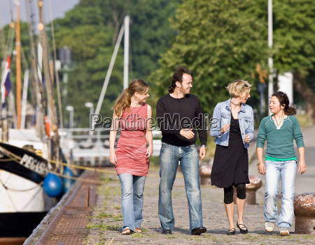 man and women walking on a