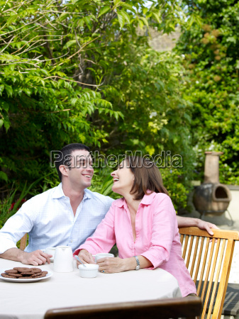 man and woman sitting at table