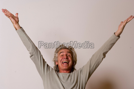 man with arms raised in celebration