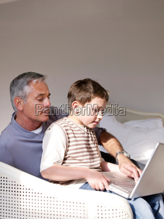 father and son on laptop in