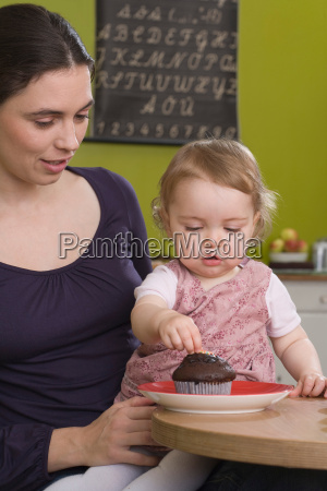 young girl on mothers lap with