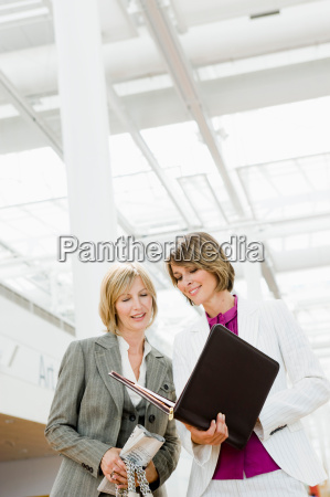 two women looking at files