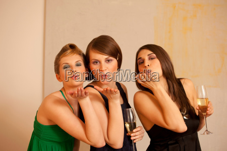 young women blowing kisses