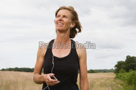 woman runner listening to music on