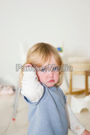 a little girl looking grumpy