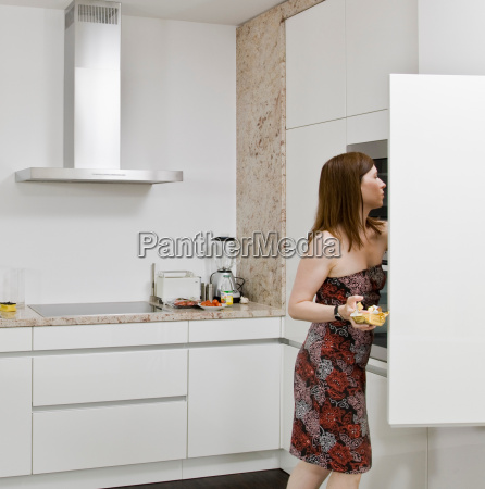 woman looking for food in the