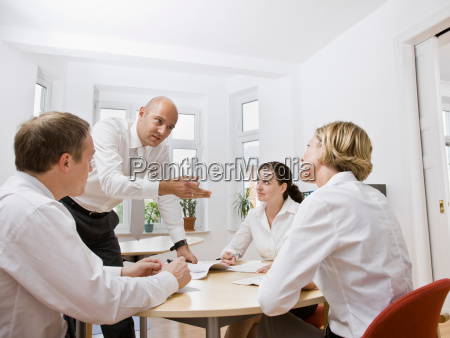 coworkers talking over a meeting