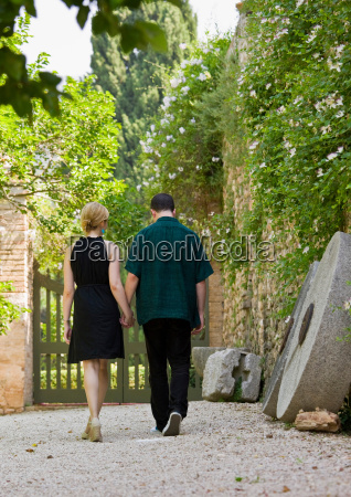 man and woman walking and holding