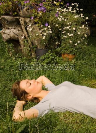 a portrait of female lying on