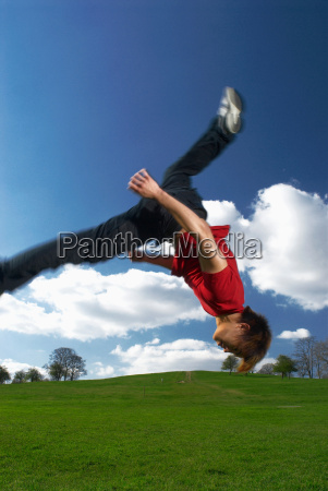 man backflipping in park