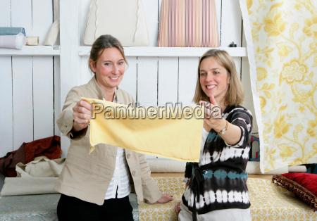 2 women choosing fabric