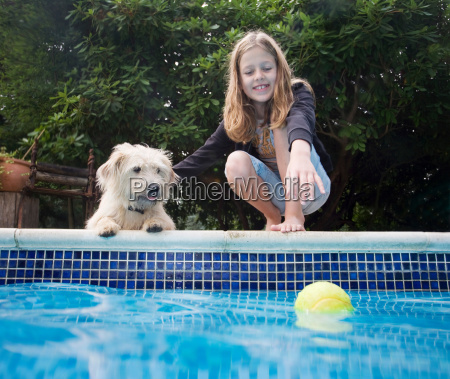 girl with dog by pool