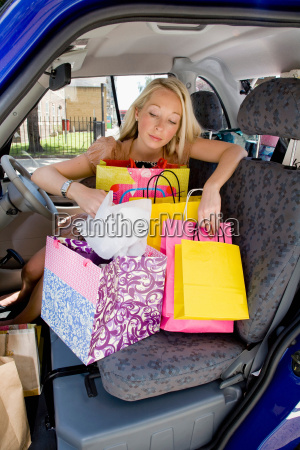 young woman sitting in electric car