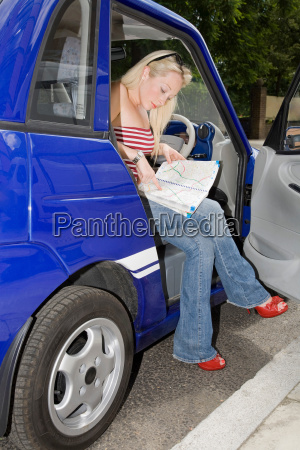 young woman reading map in electric