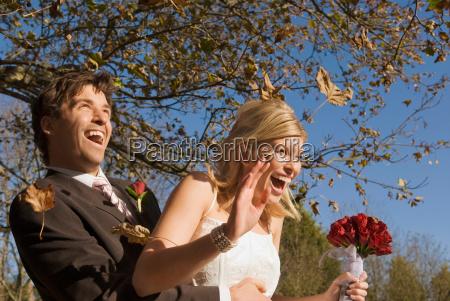 a wedding couple in an autumn