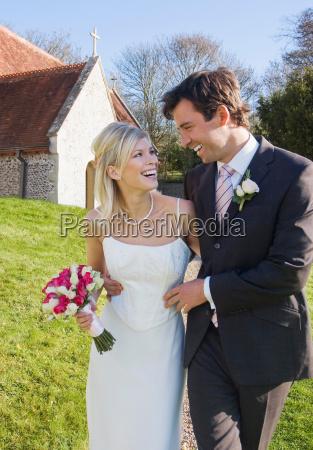 a wedding couple outside a chapel