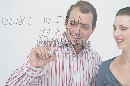 a business couple writing on a