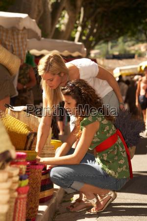 two girls shopping in market