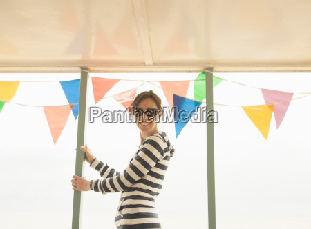 woman looking to camera past bunting