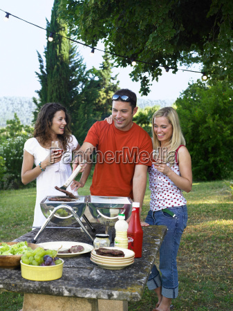 group cooking at barbecue